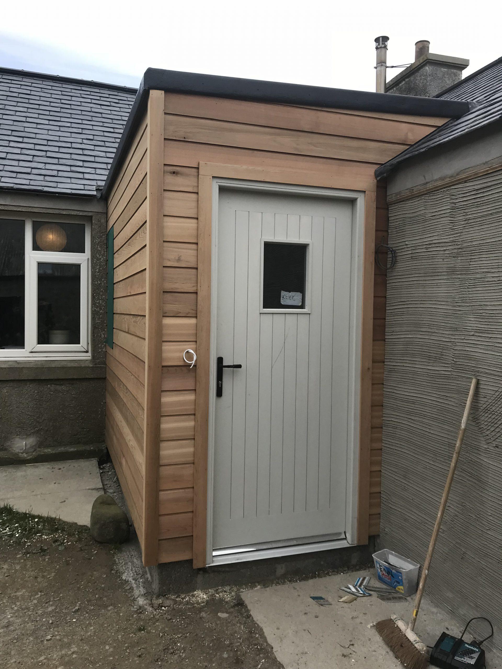 Cedar Clad Porch and Hardwood Door.