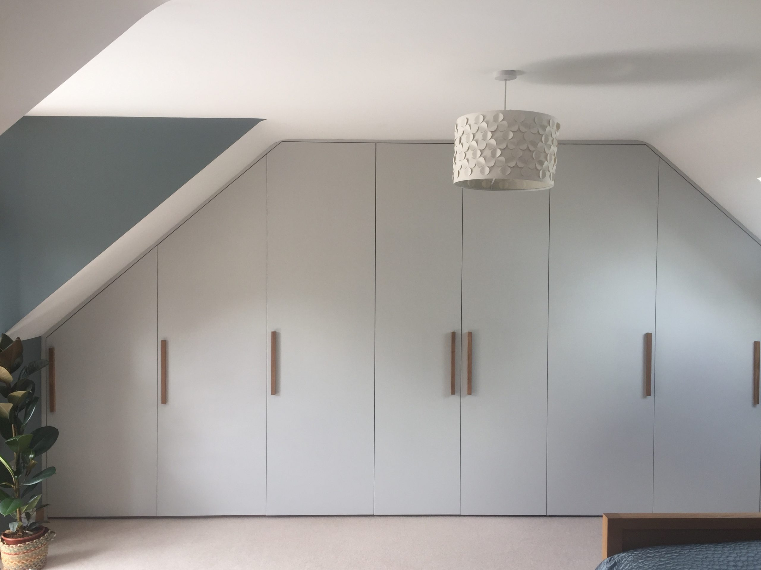 Painted door wardrobe with handmade Scottish oak handles and birch ply internal shelves and drawers.