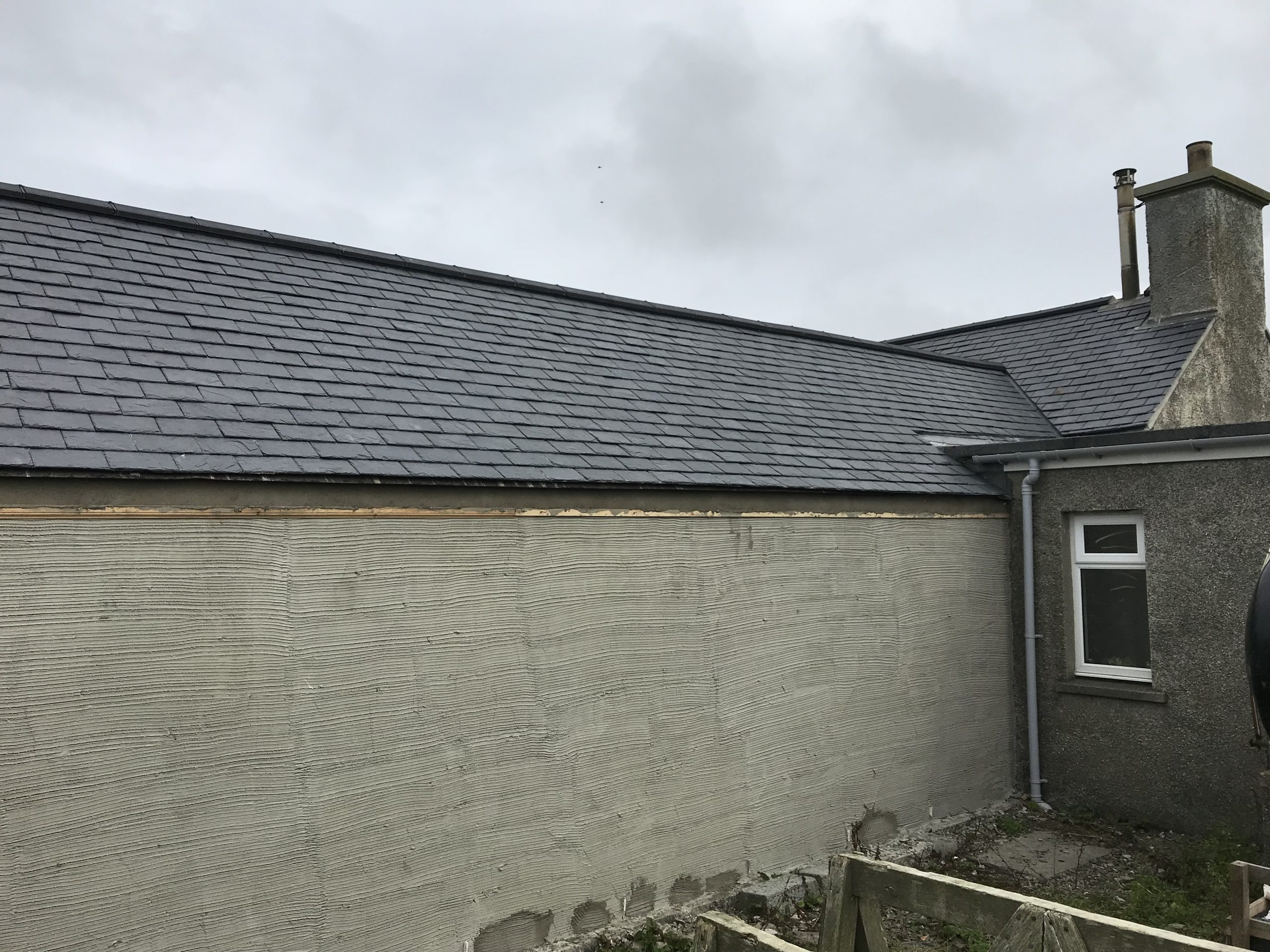 Outbuilding converted and new slate roof fitted.