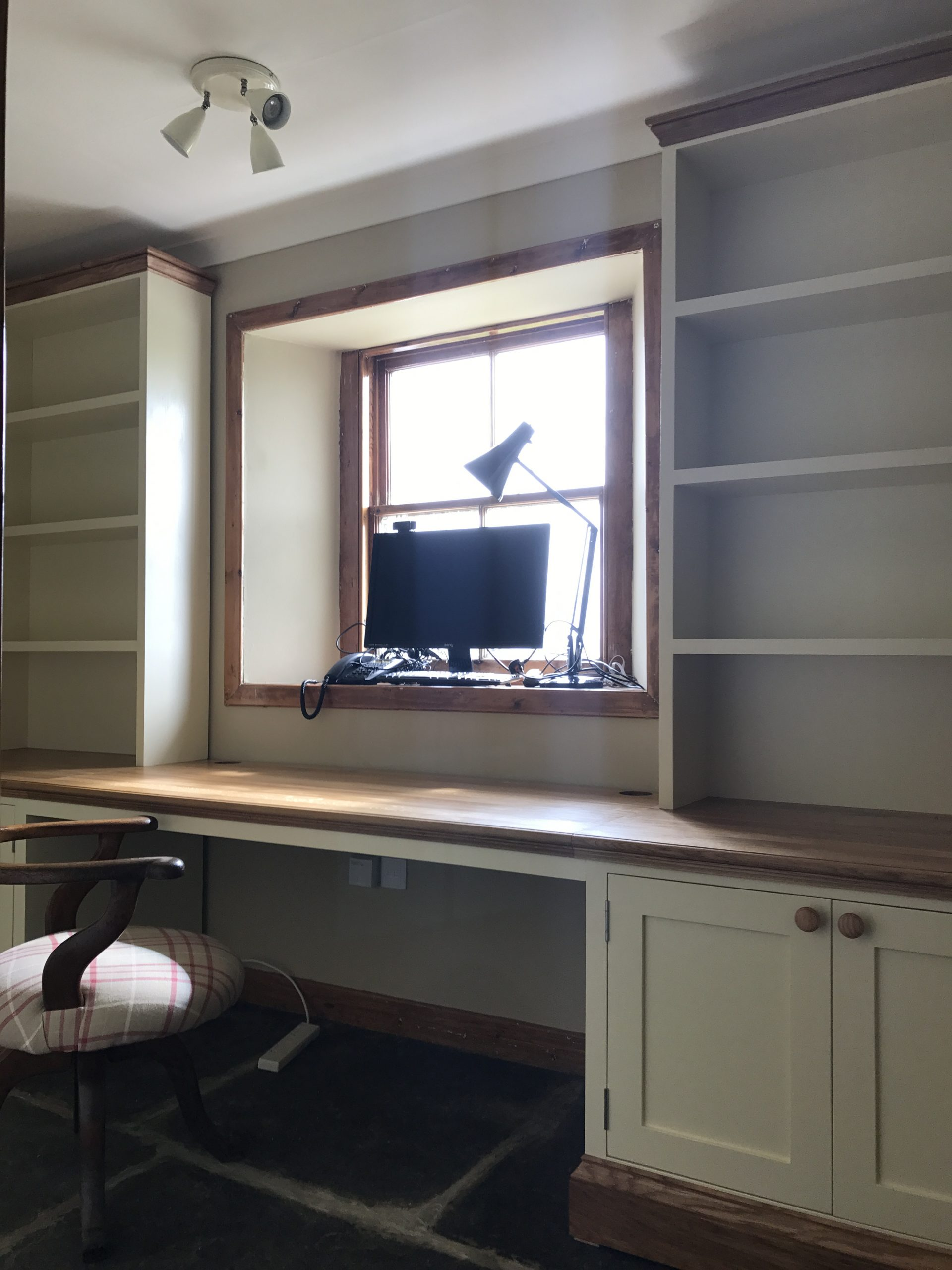 Painted Cabinets with Oak Top.